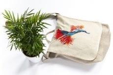 Dzikie Twory - lniana torba na chleb z pomarańczowym kwiatem obok roślinki